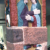 12. Ruthwell Cross (east face), top panel:the Visitation (Luke 1.41).