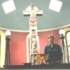 Ruthwell Cross in church, with person for scale